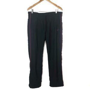 NIKE Black and Pink jogging pants size Large